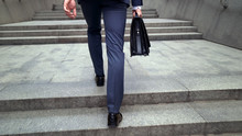 Man In Business Suit Walking U...