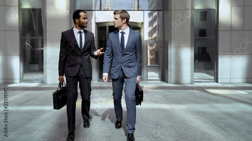 Fotografie, Obraz  Business partners leaving office center, discussing successful cooperation