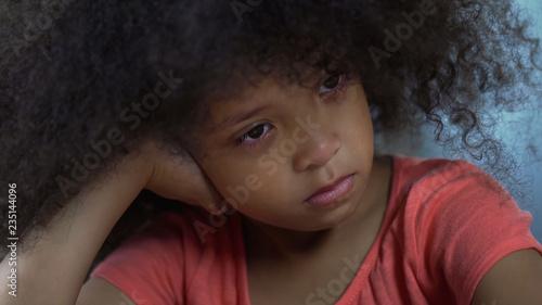 Fotografía  Sad curly female African-American kid sitting alone, punished for bad behavior