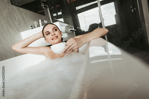 070d72617f2 Concept of enjoyment and relaxation in bathroom. Waist up portrait ...