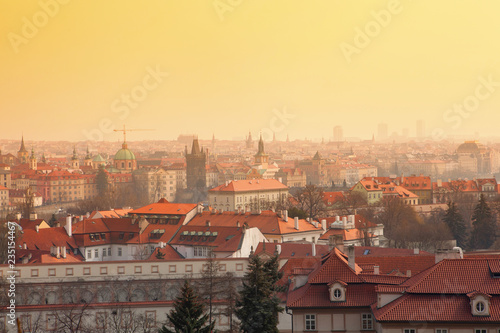 Yellow and warm sky at dusk over the gothic city of Prague