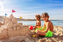 Cute Boys Building Big Sand Castle On The Beach