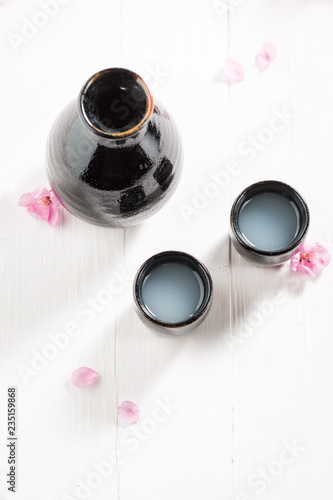 Top view of unfiltered sake on white table