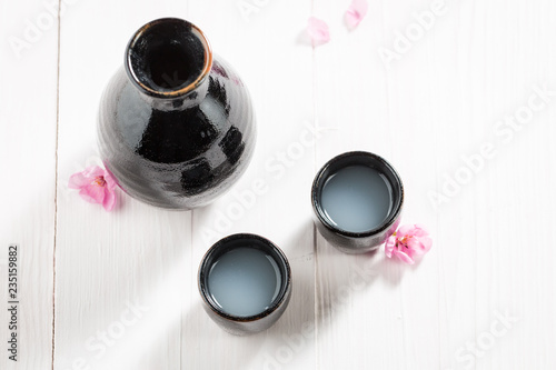 Top view of traditional sake in old black ceramics