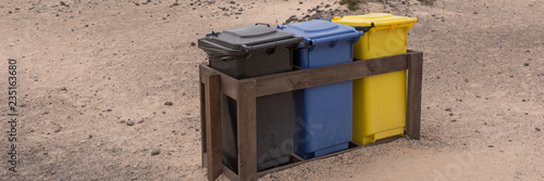 Deurstickers Canarische Eilanden Three colorful recycle bins on the beach. Fuerteventura. Canary Islands