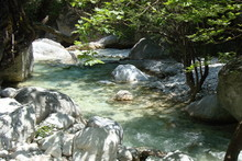 Views Of Greece, River Flowing Under Mount Olympus