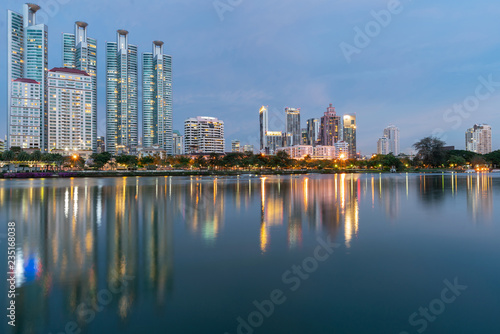 Photo Stands Kuala Lumpur Night twilight city apartment building with water reflection on lake, cityscape background