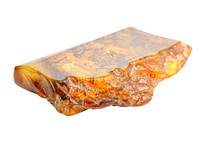 Beautiful Polished Piece Of Amber On A White Background. Unusual Forms Of Amber. Fossil Ancient Petrified Resin. Amber Piece Of Square Shape With A Broken Edge.  Sun Stone. Amber Science