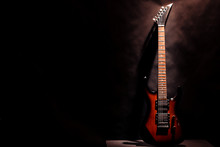 Red Electric Guitar On A Dark ...