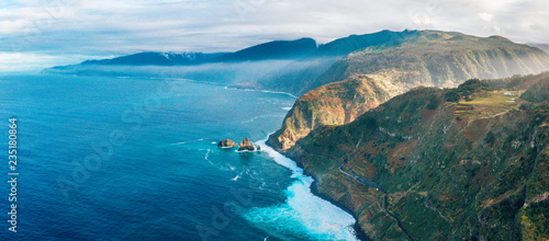 Poster Turquoise Aerial Madeira island view with Atlantic ocean, white waves, cliffs and green nature