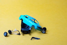 Toy Car Broken Into Pieces, Wh...