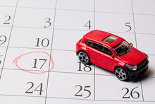Red Toy Car Is Located On The Calendar, The Number 17 Is Circled In Red