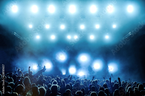 Rock concert, silhouettes of people raising hands up and crowdsurfing - 235181657