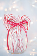 Christmas Photograph Of A Mason Jar Filled With Red And White Candy Canes On White