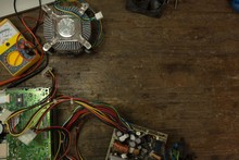Circuit Board And Multimeter On Table