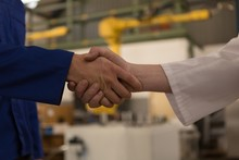 Robotic Engineers Shaking Hands With Each Other