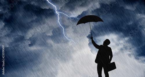 Obraz na płótnie businessman with umbrella in the rainstorm
