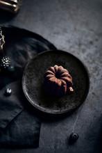 Mini Chocolate Lava Bundt Cake On Rustic Plate
