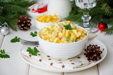 Fototapeta Traditional Russian salad with crab sticks, fresh cucumbers, corn and boiled eggs in a bowl