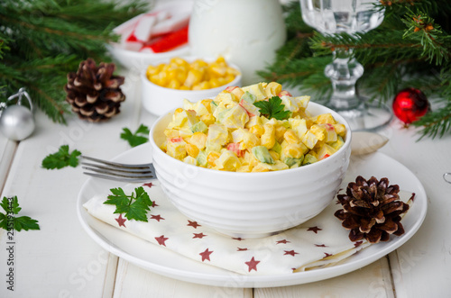 Fotografie, Obraz  Traditional Russian salad with crab sticks, fresh cucumbers, corn and boiled egg