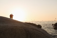 Rear View Of Couple Standing Near Sea