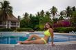 Zanzibar, woman, yellow bikini, pool