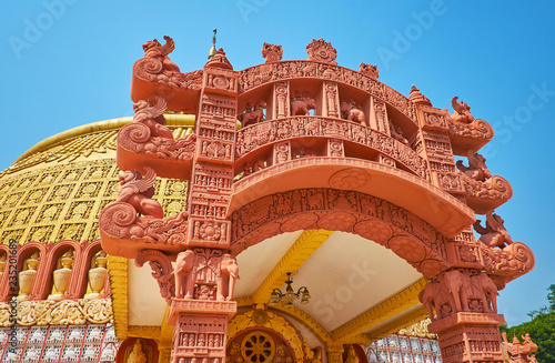 Deurstickers Asia land The stunning architecture of the temple of Sitagu International Buddhist Academy with terracotta torana gate, decorated with carved details, Sagaing, Myanmar.