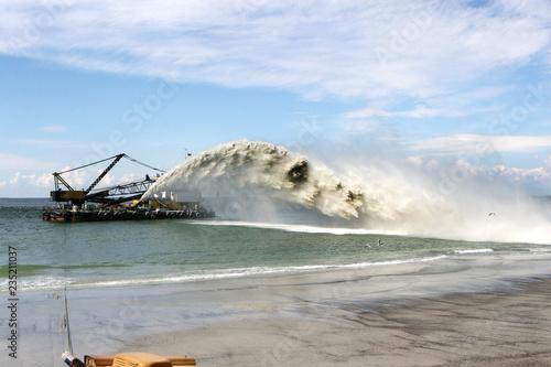 Valokuvatapetti Work dredger dredging with sand washing on beaches