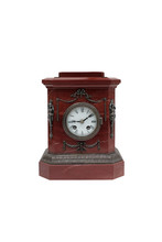 Red Marble Mantel Clock On A White Background. Isolated.