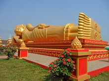 Hugh Golden Reclining Buddha Image At Wat That Luang Tai Temple, Part Of PhaThat Luang Complex In Vientiane, Laos
