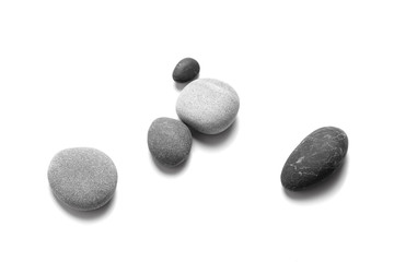 Fototapeta na wymiar Scattered sea pebbles. Smooth gray and black stones isolated on white background. Top view