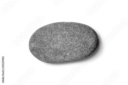 Fotomural  Pebble. Smooth dark gray sea stone isolated on white background