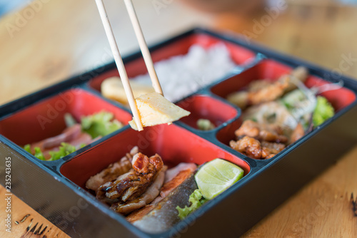 Photo bento box with sushi and rolls