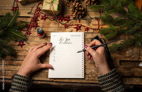Fotografie, Obraz  Woman writing her New Year resolutions