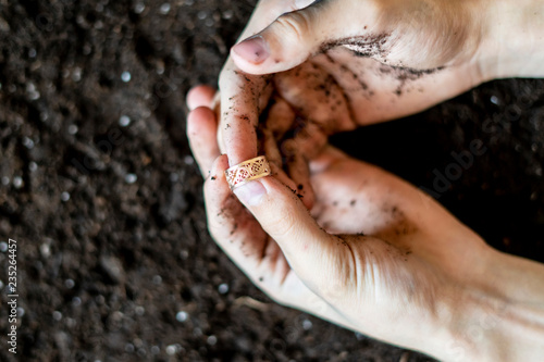 Fotografie, Obraz  finding a precious golden ring in the soil ground f