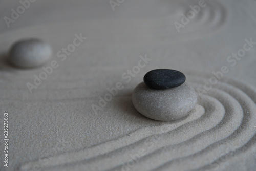 Poster de jardin Zen pierres a sable Gray zen stones on the sand with wave drawings. Concept of harmony, balance and meditation, spa, massage, relax