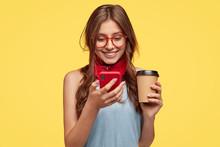 Cheerful Girl Has Coffee Break...