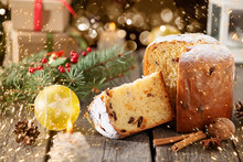 Traditional Italian Christmas Fruit Cake Panettone  With Christmas Decorations, Gift Box And Mulled Wine, On Wooden Home Background, Copy Space.