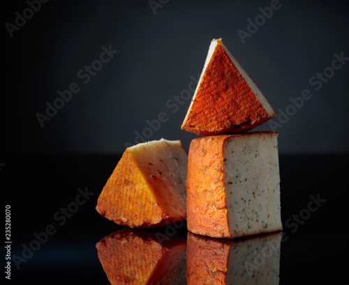 Red Pecorino sheep milk cheese with pepper and spices.
