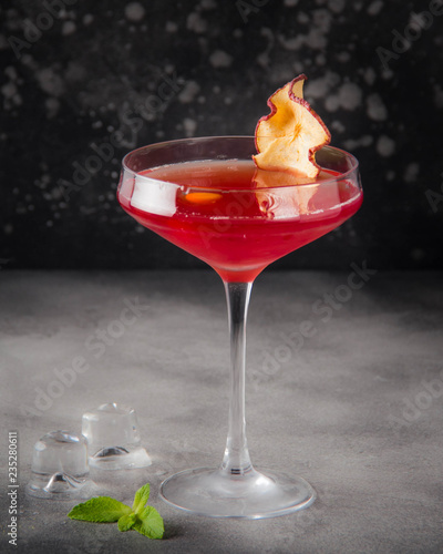 Red orange cocktail in glass, delicious alcoholic drink to celebrate