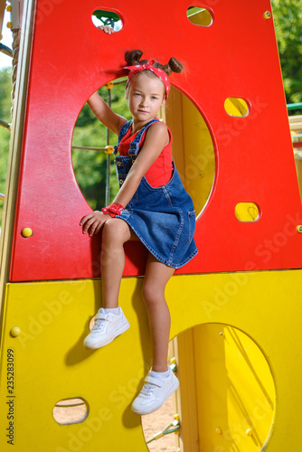 Fotografie, Obraz  little girl is playing on the playground