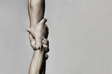 Helping Hand Concept And International Day Of Peace, Support. Helping Hand Outstretched, Isolated Arm, Salvation. Close Up Help Hand. Two Hands, Helping Arm Of A Friend, Teamwork. Black And White