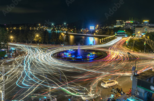 Garden Poster Buenos Aires Da Lat, Vietnam - October 27th, 2018: Roundabout intersections with lights night market, creating in streaks of color motorcycle stayed in the city for the evening mist Da Lat, Vietnam
