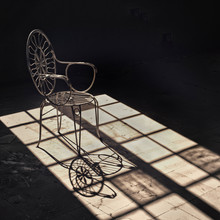 Old Wrought Iron Chair In An A...