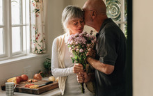 Romantic Senior Couple At Home Expressing Their Love