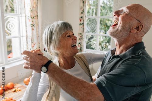 Fotografie, Obraz Senior couple laughing and having fun dancing