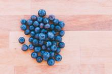 Heap Of Blueberries On Parquet
