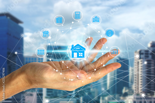 Hand holding with property investment icons