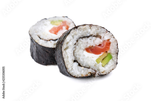 two isolated sushi rolls