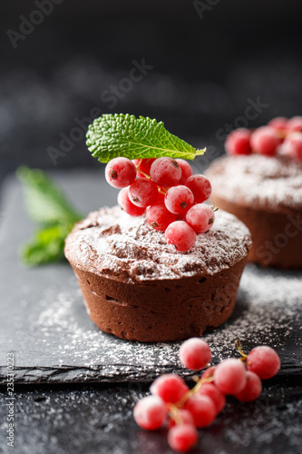 Deurstickers Dessert Classic chocolate fondant on a dark background. Chocolate muffins